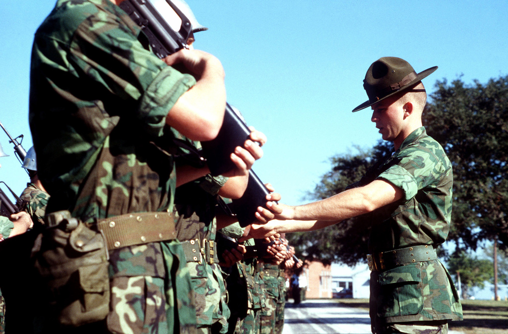 Marine recruits drill with M16A1 rifles during basic training at the Marine Corps Recruit Depot