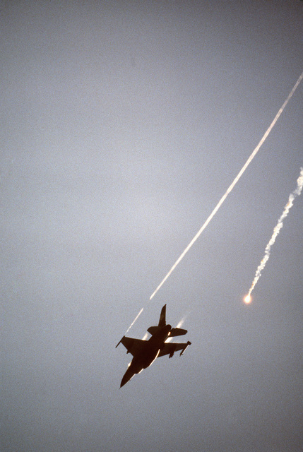 An F-16A Fighting Falcon aircraft from the 8th Tactical Fighter Wing drops a flare over the Crow Valley Electronic Warfare Tactical Range during Exercise COPE THUNDER '84-7. The flare is designed to misguide heat-seeking missiles
