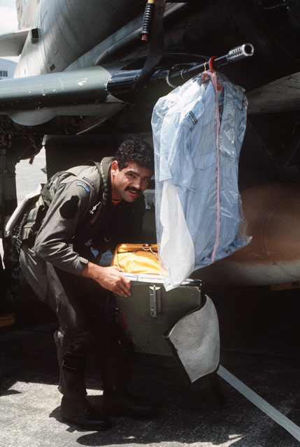 Field Grade Officer J.A. Osborne of the 75th Squadron, Royal New Zealand Air Force, unpacks his uniform and personal articles from underneath an A-4K Skyhawk aircraft during Exercise COPE THUNDER '84-7