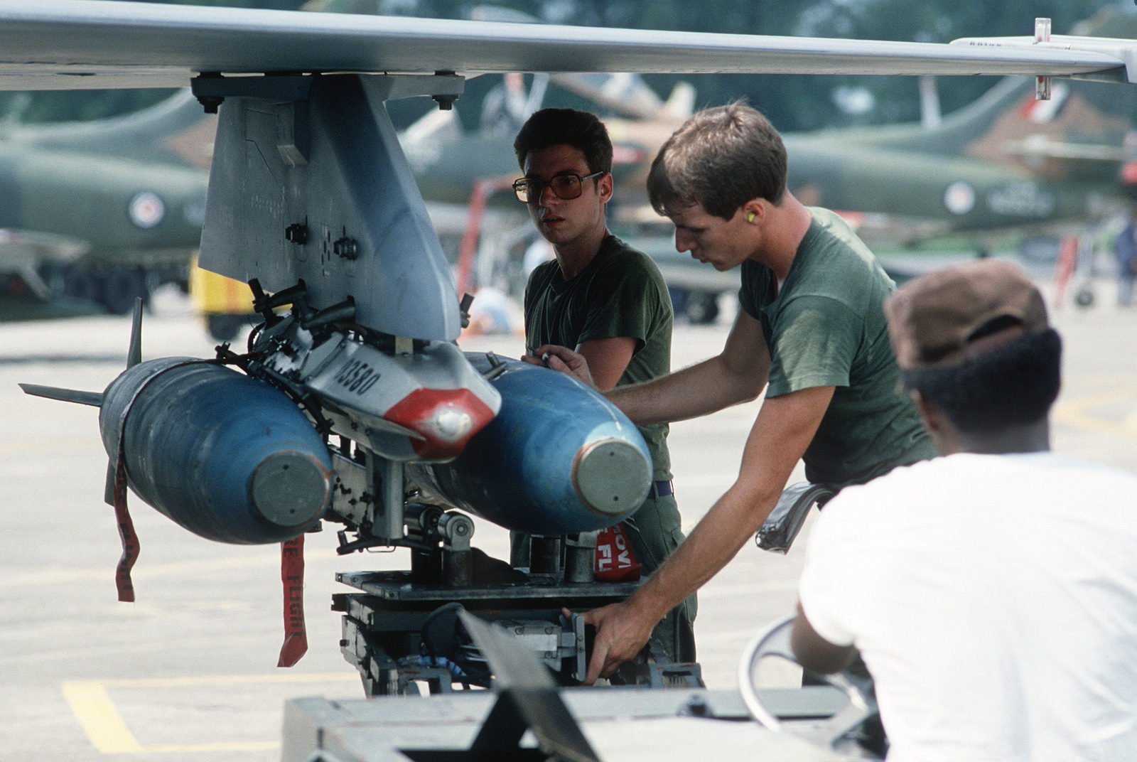 Members Of The 8th Aircraft Generation Squadron Load Inert Mark 82 500 Pound Bombs Onto An
