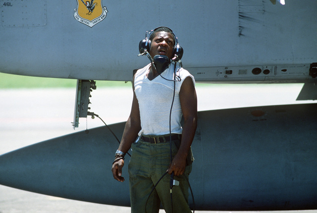 SENIOR AIRMAN (SRA) Eric Washington, a crew chief with the 18th Tactical Fighter Wing, watches an aircraft take off during Exercise COPE THUNDER '84-7