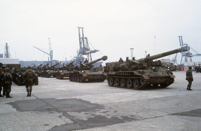 M110 203 mm self-propelled Howitzers are staged in a parking area after being unloaded from a ship during Exercise REFORGER '84
