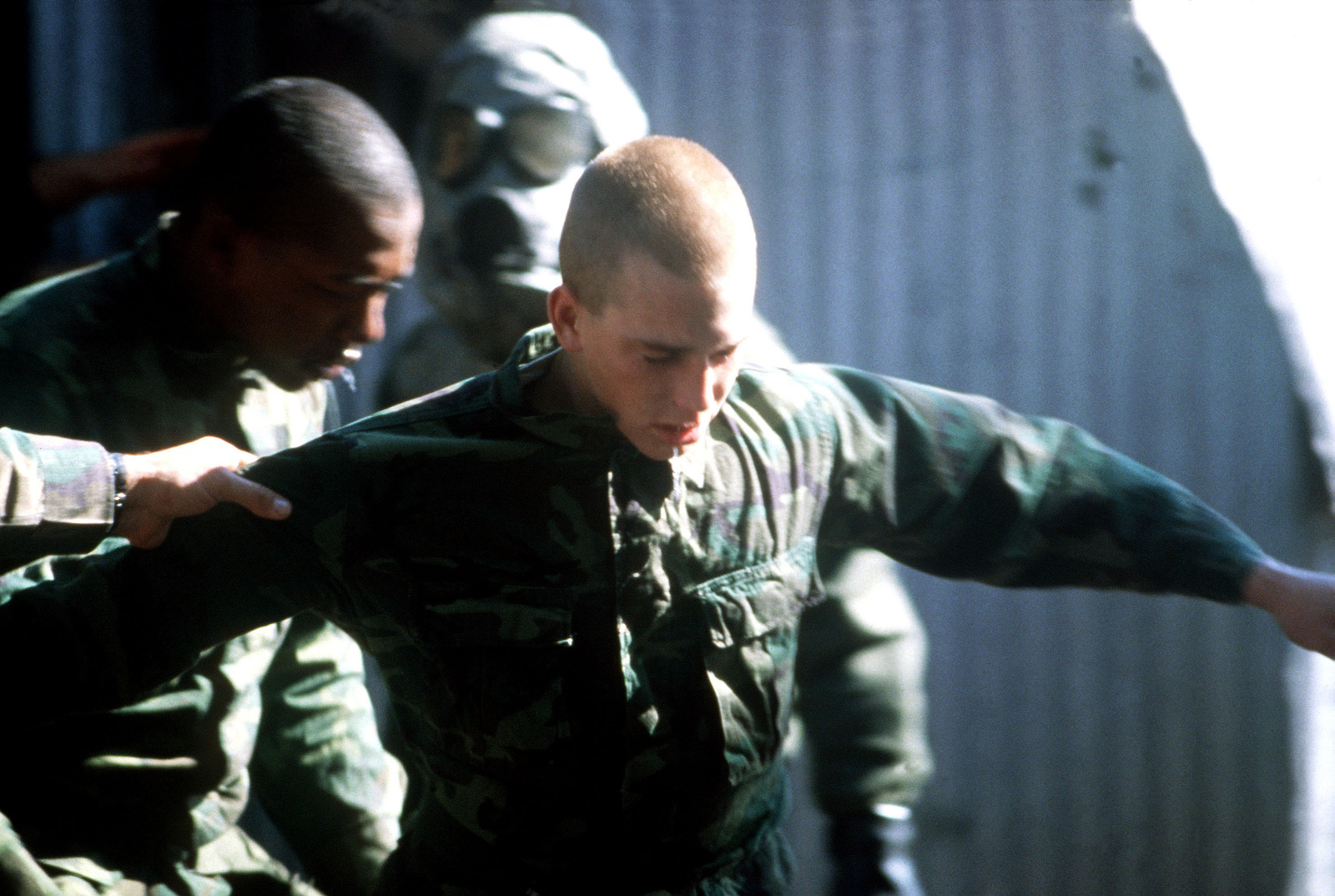 Recruits try to maintain their balance after being exposed to a chemical agent in a gas chamber. They are undergoing basic training at the Marine Corps Recruit Depot