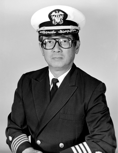 Captain (CAPT) Clinton M. Furuya, USN (covered)