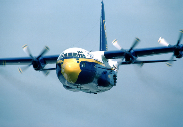 """A left front view of the Blue Angels Flight Demonstration Squadron KC-130F Hercules aircraft, unofficially known as """"Fat Albert,"""" in flight. Operated by a Marine Corps crew, the aircraft transports personnel, fuel, an supplies to Blue Angels performance"""