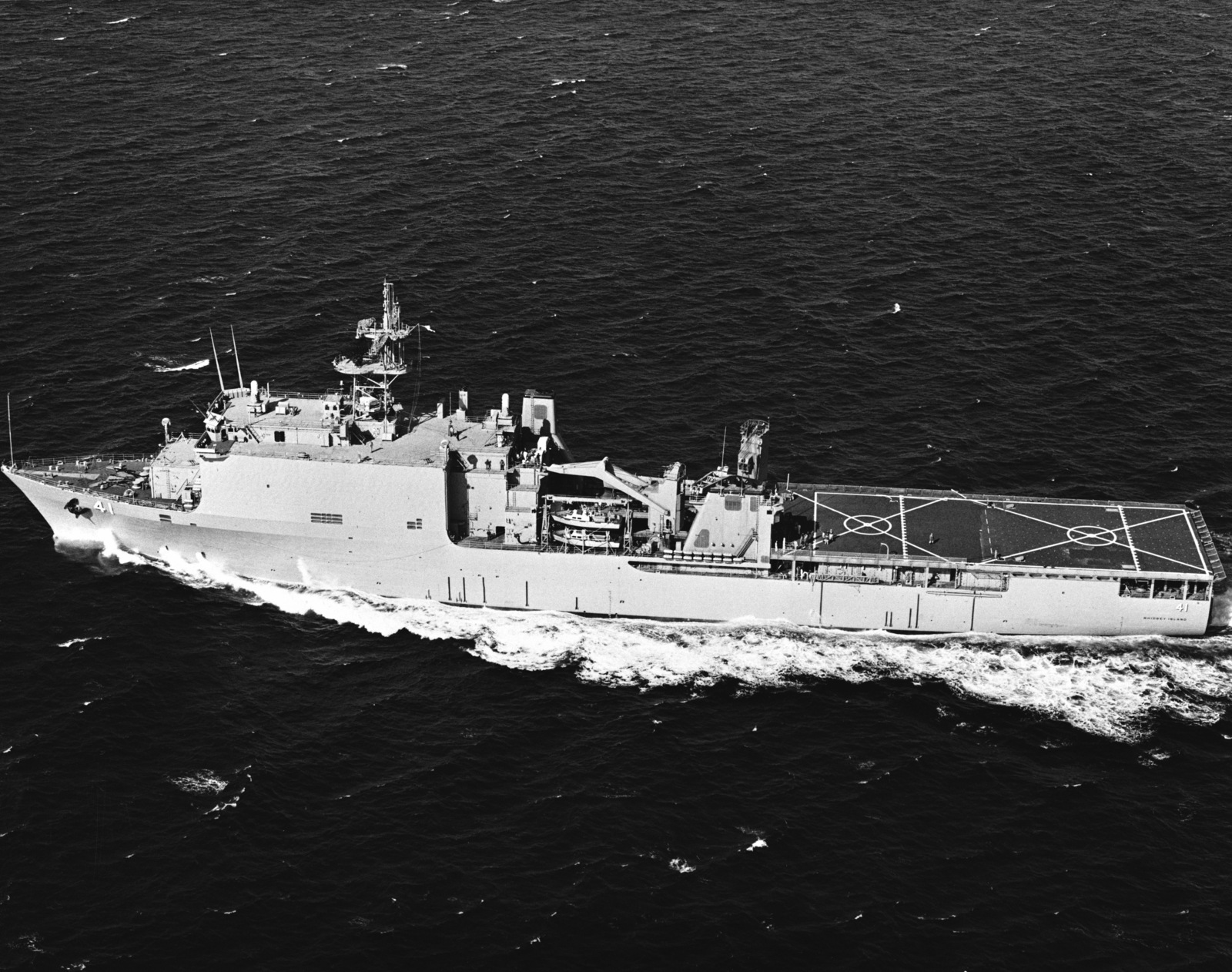 Aerial port beam view of the dock landing ship USS WHIDBEY ISLAND (LSD 41) underway