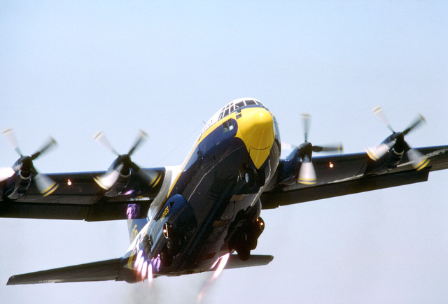 """The Blue Angels Flight Demonstration Squadron 130F Hercules aircraft, unofficially known as """"Fat Albert,"""" makes a jet-assisted takeoff (JATO). Operated by a Marine Corps crew, the aircraft transports personnel, fuel, and supplies to Blue Angels performances"""