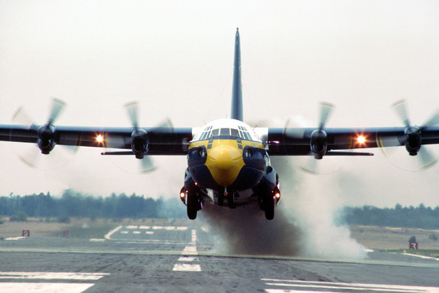 """The Blue Angels Flight Demonstration Squadron C-130 Hercules aircraft, unofficially known as """"Fat Albert,"""" makes a jet-assisted takeoff. Operated by a Marine Corps crew, the C-130 transports personnel, fuel, and supplies to Blue Angels performances"""