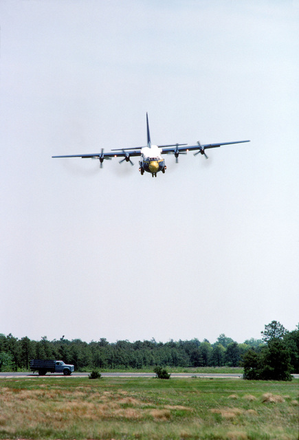 """The Blue Angels Flight Demonstration Squadron KC-130F Hercules aircraft, unofficially known as """"Fat Albert,"""" approaches the runway for a landing. Operated by a Marine Corps crew, the aircraft transports personnel, fuel, and supplies to Blue Angels performances"""