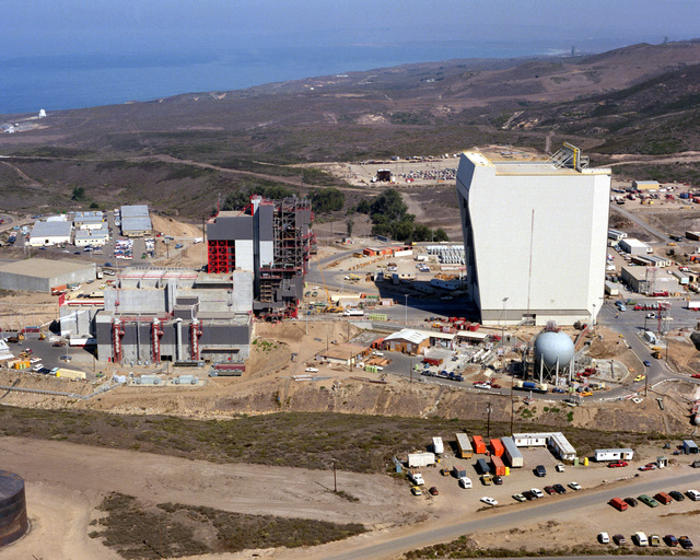 Aerial view, looking north, of Space Launch Complex No. Six (SLC-6) with the Payload Preparation Room (PPR), the Payload Changeout Room (PCR), and the Storage and Assembly Building (SAB) under construction