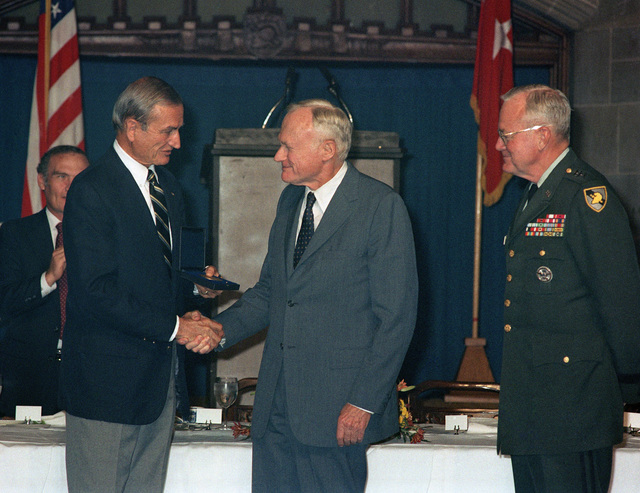 "Former Secretary of the Army (1965-1971) Stanley Resor, center, receives the Thayer award as Lieutenant General Willard Scott Jr., Superintendent, US Military Academy looks on. This annual award is presented to citizens whose services and accomplishments best exemplify the academy's motto - ""Duty, Honor, Country."""