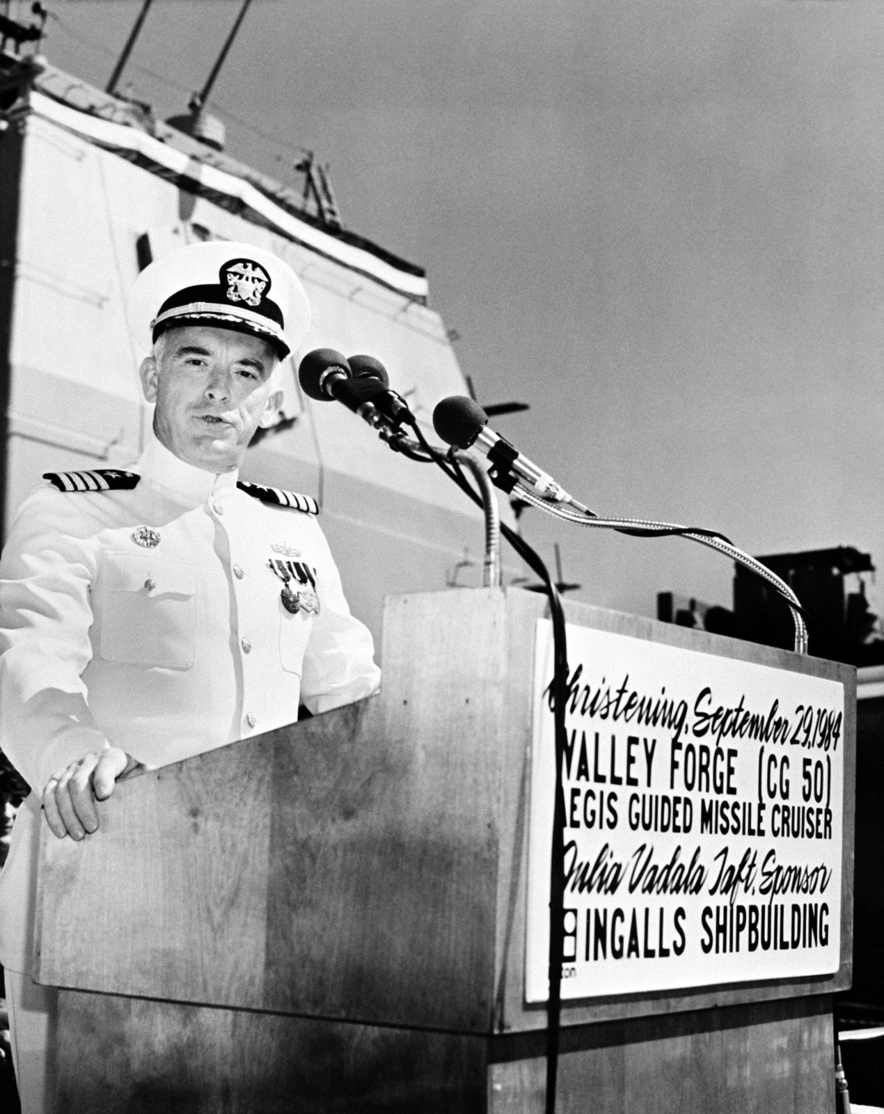 Captain George W. Dowell III, supervisor of shipbuilding, Pascagoula, speaks during the christening ceremony for the Aegis guided missile cruiser USS VALLEY FORGE (CG 50)