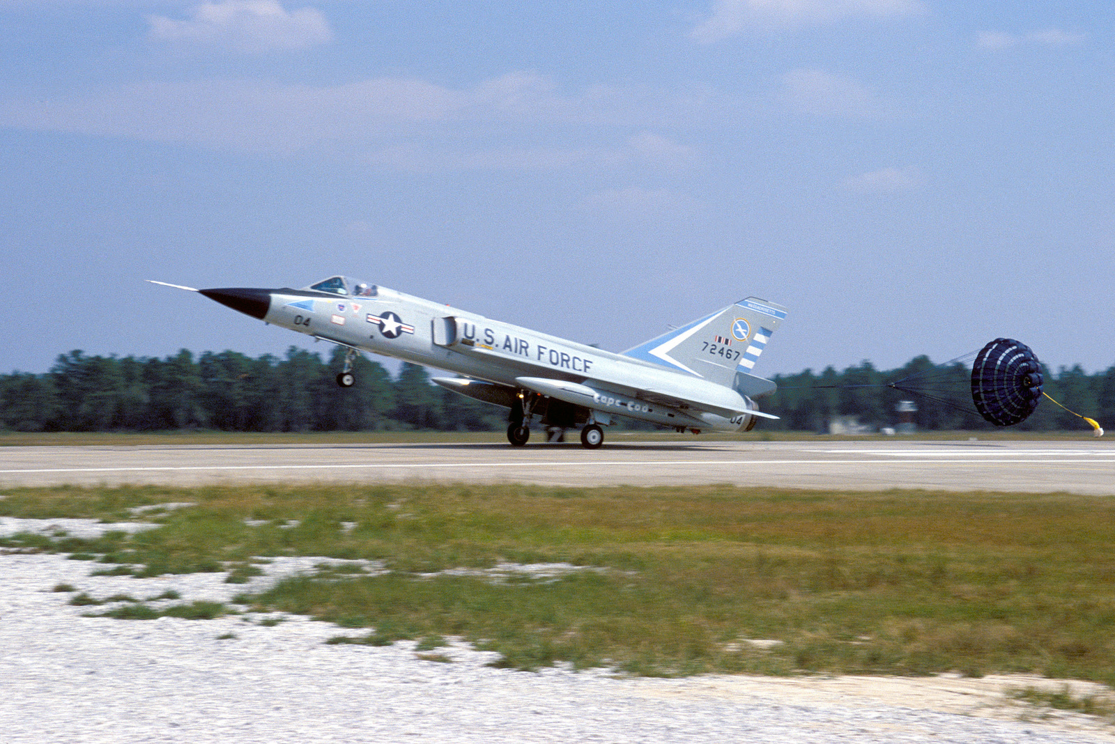 A Massachusetts Air National Guard F-106 Delta Dart aircraft from 102nd Fighter Interceptor Wing arrives at the base to compete in the air-to-air weapons meet WILLIAM TELL '84. A drag chute is deployed from the tail of the aircraft