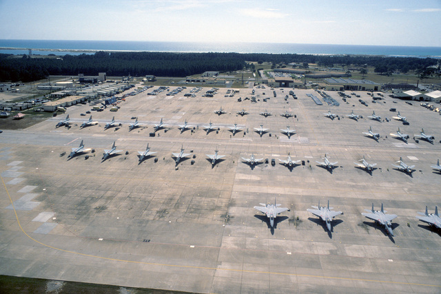 An aerial view of F-15 Eagle, F-4 Phantom II and F-106 Delta Dart aircraft on the parking apron during the air-to-air weapons meet WILLIAM TELL '84