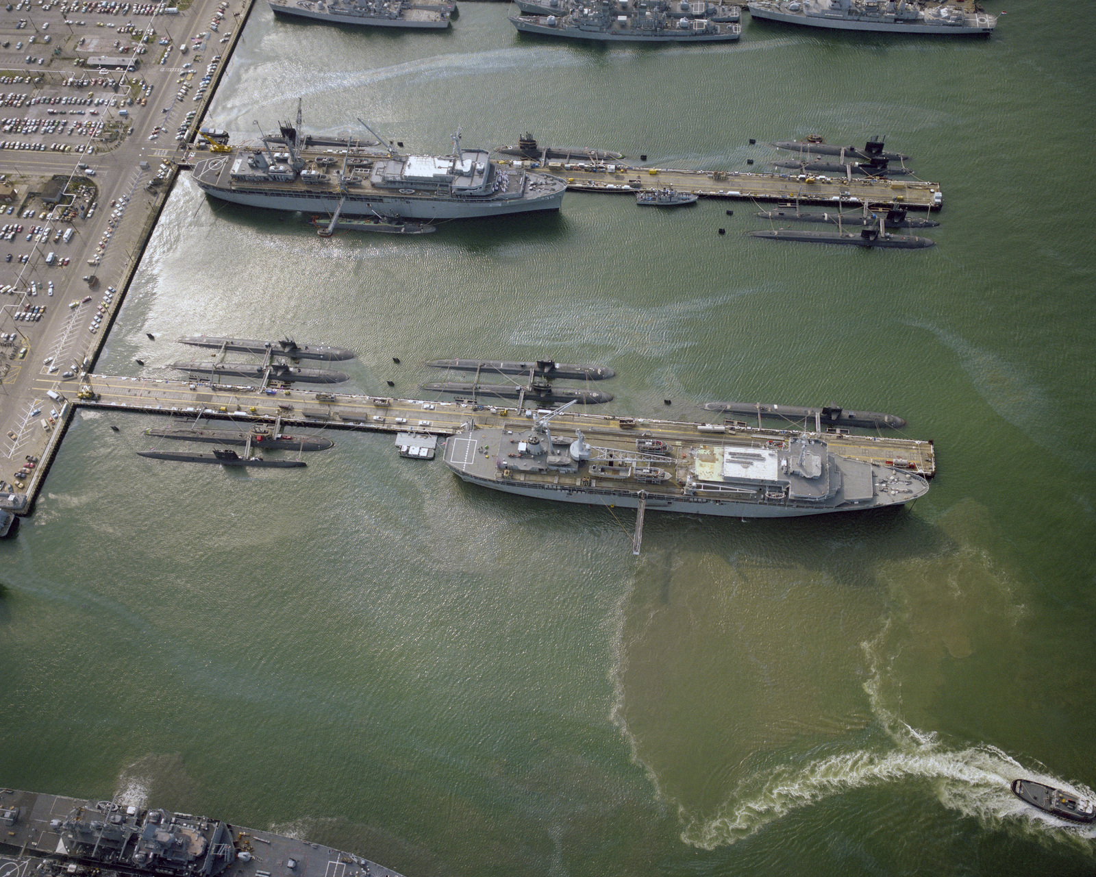 An aerial view of the destroyer and submarine piers (Nos. 22 and 23) with various ships at anchor