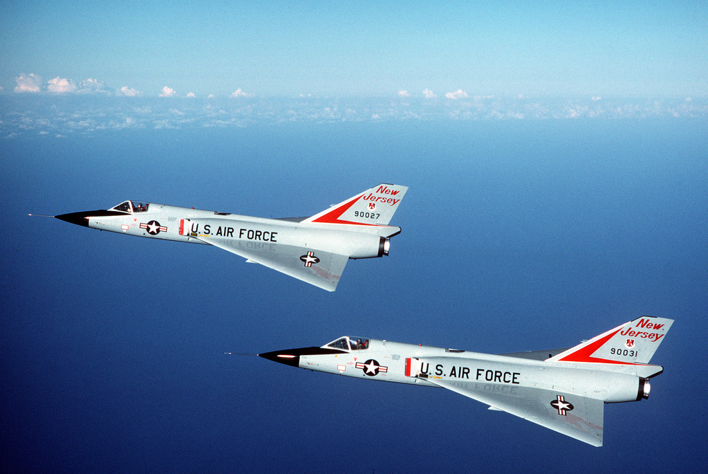 An air-to-air left side view of two F-106 Delta Dart aircraft from the 177th Fighter Interceptor Group, New Jersey Air National Guard, in formation during the air-to-air weapons meet WILLIAM TELL '84