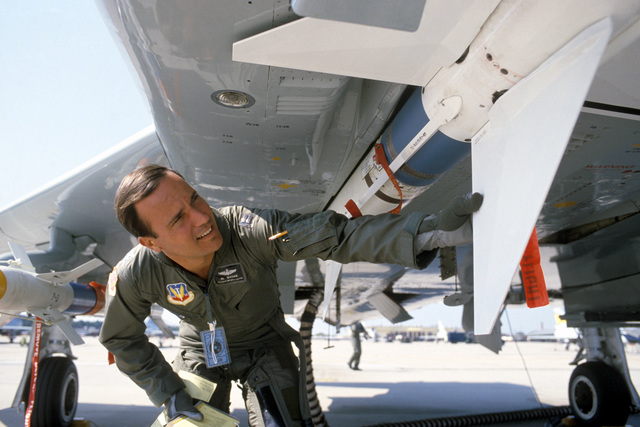 Captain Al Madar of the 191st Fighter Interceptor Group, Michigan Air National Guard, inspects an AIM-7 Sparrow missile mounted on his F-4C Phantom II aircraft. Madar is conducting a preflight check of his aircraft during the air-to-air weapons meet WILLIAM TELL '84
