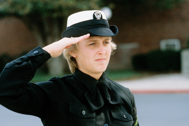 Photographer's Mate AIRMAN Tina Brown salutes during morning colors at the Naval Audiovisual Center, Naval Station Anacostia