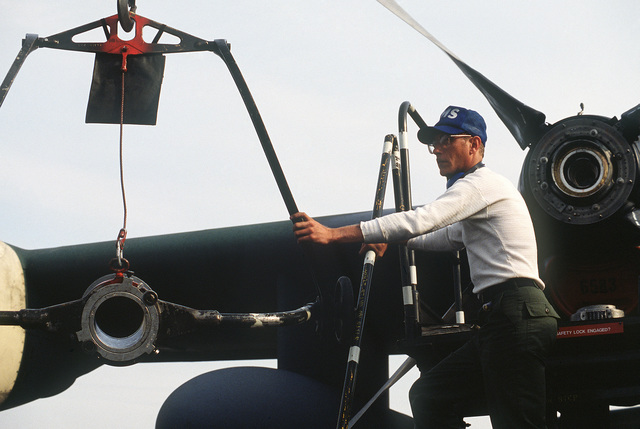 A member of the 435th Maintenance Squadron helps install a new propeller on a C-130 Hercules aircraft during an operational readiness exercise