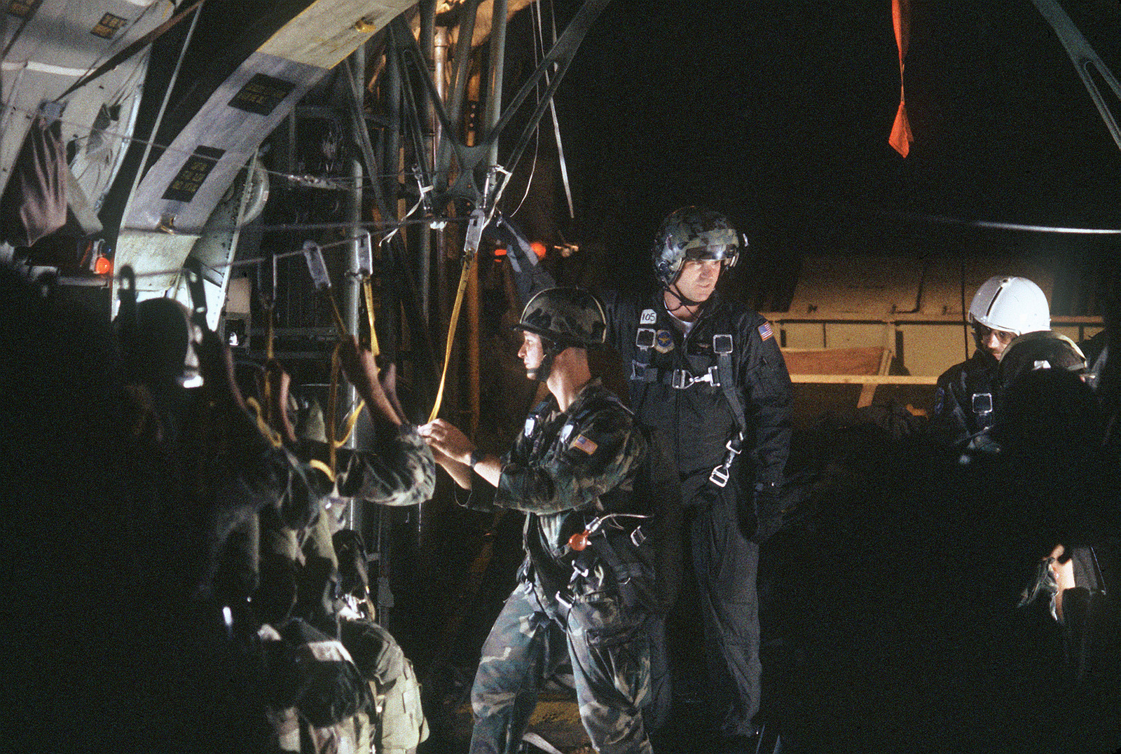 Members of the 509th Airborne Ranger Battalion prepare for an airdrop from a 37th Tactical Airlift Squadron C-130 Hercules aircraft during an operational readiness exercise