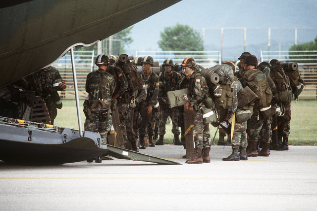 Members of the 509th Airborne Ranger Battalion prepare to board a 37th Tactical Airlift Squadron C-130 Hercules aircraft for an airdrop during an operational readiness exercise