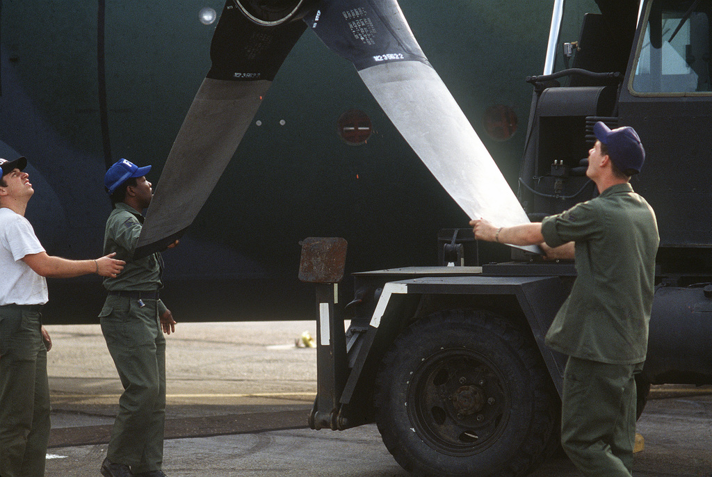 Personnel from the 435th Maintenance Squadron change a propeller on a C-130 Hercules aircraft during an operational readiness exercise