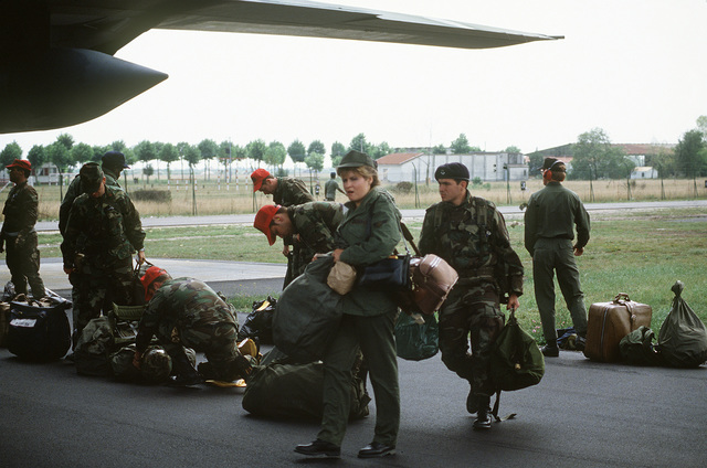 Support personnel from the 435th Tactical Airlift Wing arrive at the air base during an operational readiness exercise