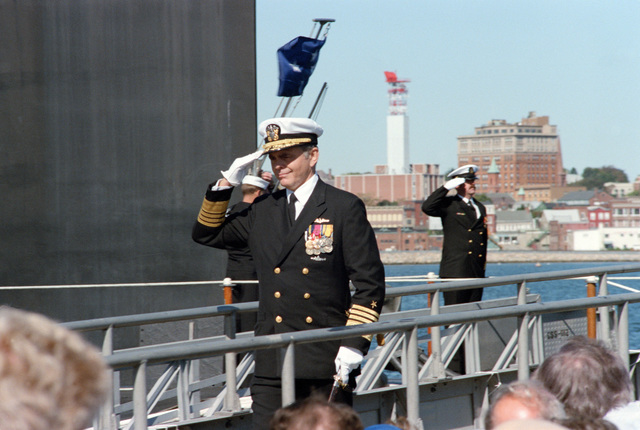 Admiral Kinnaird R. McKee, Deputy Commander for Nuclear Propulsion, Naval Sea Systems Command, arrives for the commissioning of the Ohio class nuclear-powered strategic missile submarine USS HENRY M. JACKSON (SSBN 730)