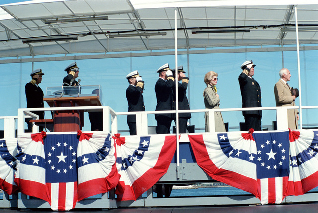 Guests honor the flag during the commissioning ceremony for the nuclear-powered strategic missile submarine USS HENRY M. JACKSON (SSBN 730). Vice Admiral Nils R. Thunman, Deputy CHIEF of Naval Operations, Submarine Warfare, is at left and Admiral Kinnaird R. Mckee, Deputy Commander for Nuclear Propulsion, Naval Sea Systems Command, is third from left