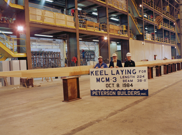Keel layin for the mine countermeasures ship USS SENTRY (MCM 3). The participants are, left to right: Jerome Kostichka, ship manager, Peterson Builders, Inc., E.L. Peterson, president, Peterson Builders, Inc., and Lieutenant (LT) Richard Goldsworthy, Project Officer, Supervisor of Shipbuilding