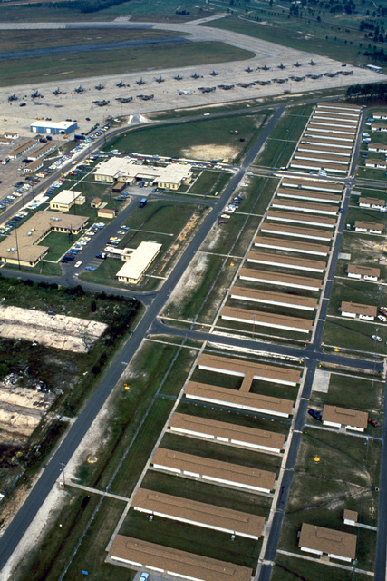 An aerial view of the base with RF-4C Phantom II and RF-8G Crusader aircraft on the flight line during Exercise PHOTO FINISH '81