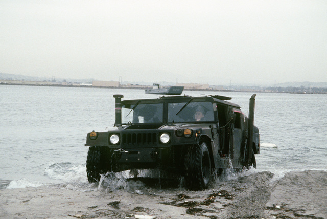 An M998 High-Mobility Multipurpose Wheeled Vehicle drives ashore in a test conducted by the US Marine Corps. The M998 will replace several lightweight vehicles used by the military services