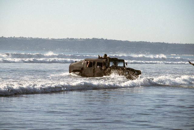 An M998 High-Mobility Multipurpose Wheeled Vehicle is driven ashore in a test conducted by the US Marine Corps. The M998 will replace several lightweight vehicles used by the military services