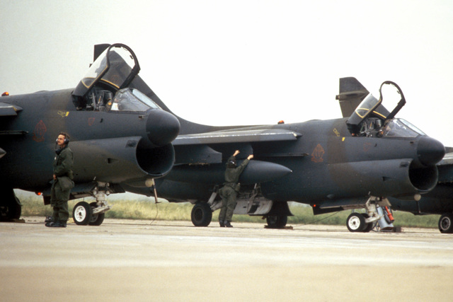 Members of the 127th Tactical Fighter Wing, Michigan Air National Guard, perform pre-flight maintenance on A-7 Corsair II aircraft during Exercise CORONET PACKER