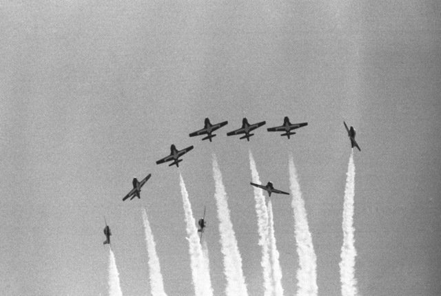 The Snowbirds, a Canadian military aerial demonstration team, perform during an air show. The nine-ship team flies CT-114 Tutor aircraft