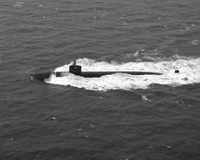 Aerial port beam view of the nuclear-powered attack submarine USS OLYMPIA (SSN 717) underway