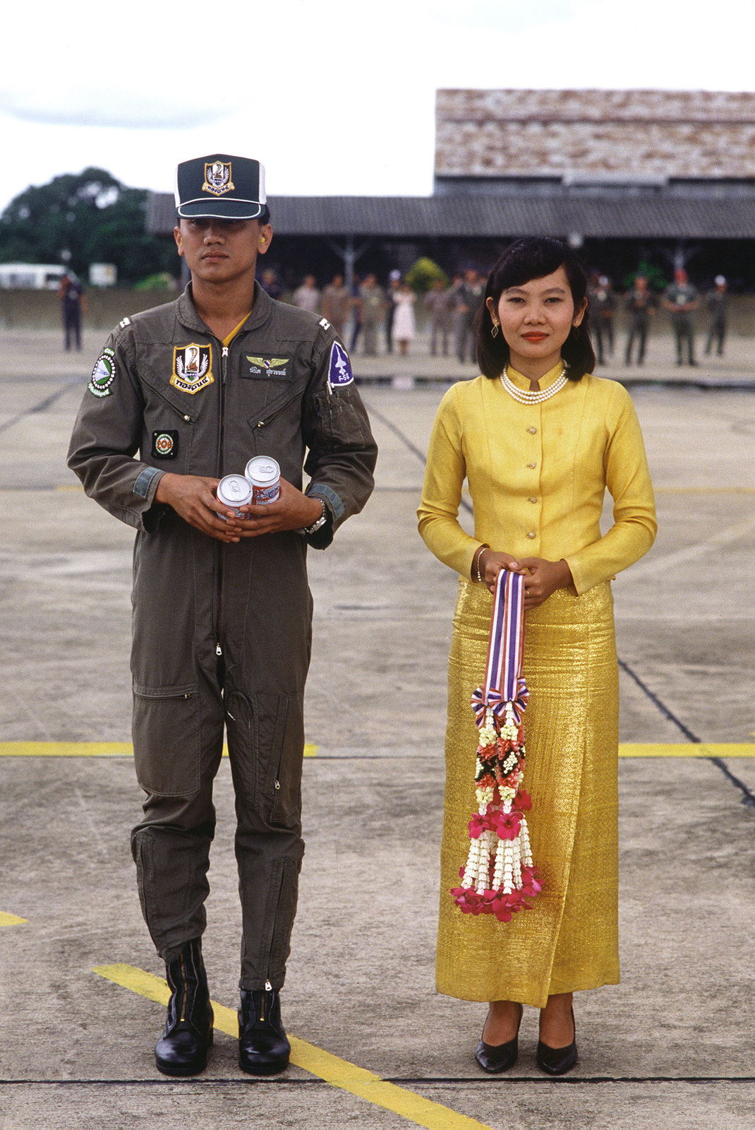 A Thai pilot and a VIP pose for a photograph during the joint Thai