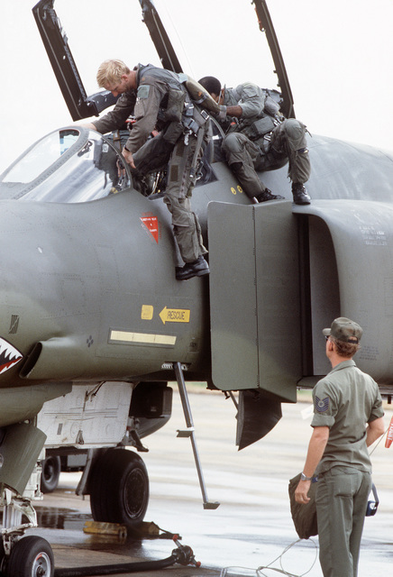 A US aircrew climbs aboard an F-4 Phantom II aircraft during the joint Thai/US Air Force Exercise COMMANDO WEST VIII