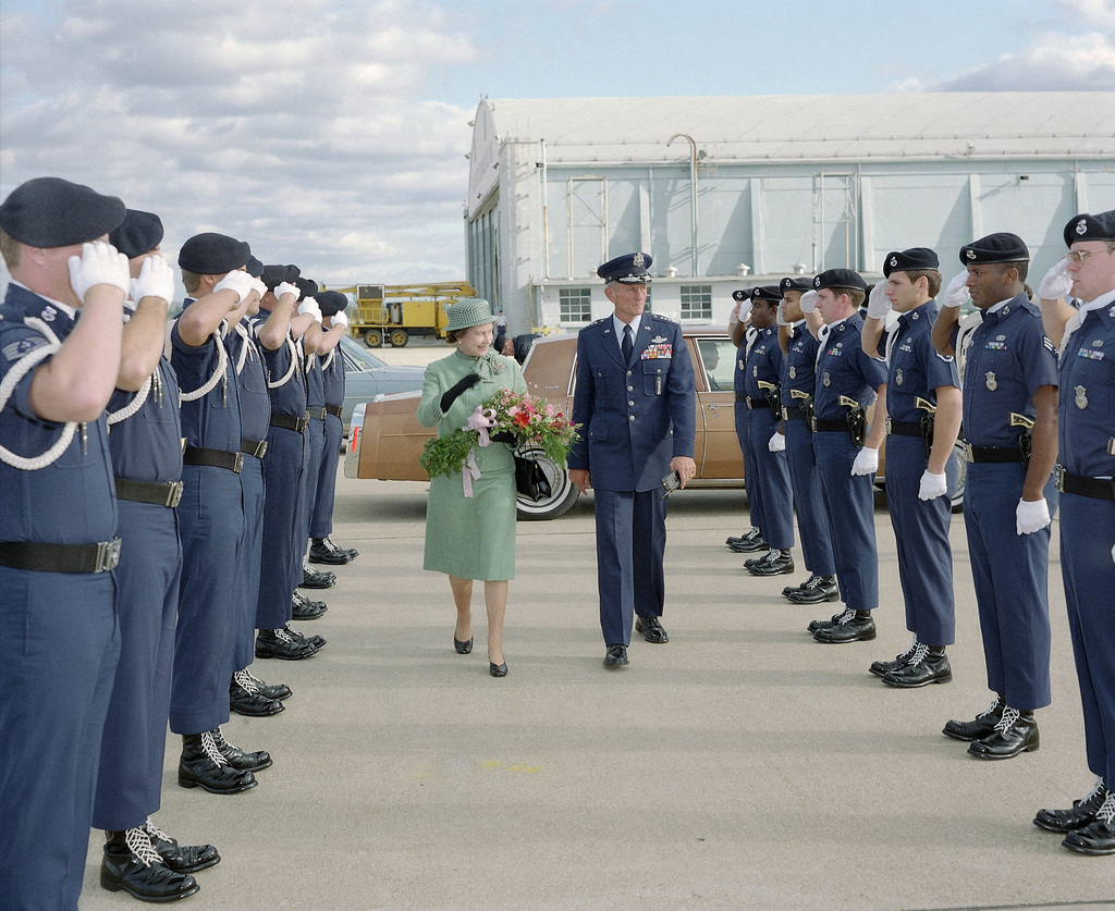 General (GEN) Bennie L. Davis, commander in chief, Strategic Air Command, and Queen Elizabeth II of the United Kingdom of Great Britian and Northern Ireland review the Strategic Air Command Elite Guard during a brief visit by the Queen