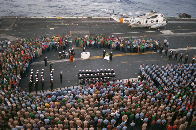 Crew members bow their heads in prayer during the memorial service for Aviation Machinist's Mate 3rd Class Charles D. Elliot, who was lost at sea in heavy weather while serving aboard the USS DWIGHT D. EISENHOWER (CVN 69)