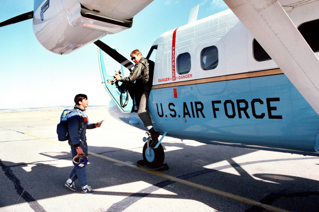 A cadet prepares to board a UV-18B aircraft while participating in the cadet-conducted parachuting program at the US Air Force Academy
