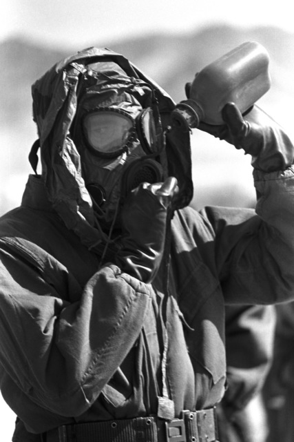 A Marine takes a drink through his M-17A1 protective mask during a 27th Marine Regiment nuclear, biological and chemical exercise held at the Marine Corps Air Ground Combat Center