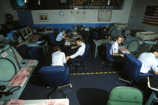 Air Force personnel at work at the Missile Warning Agency inside the North American Air Defense (NORAD) Space Command Cheyenne Mountain Complex