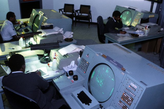 Air Force personnel at work in the Air Defense Operations Center at the North American Air Defense (NORAD) Space Command Cheyenne Mountain Complex