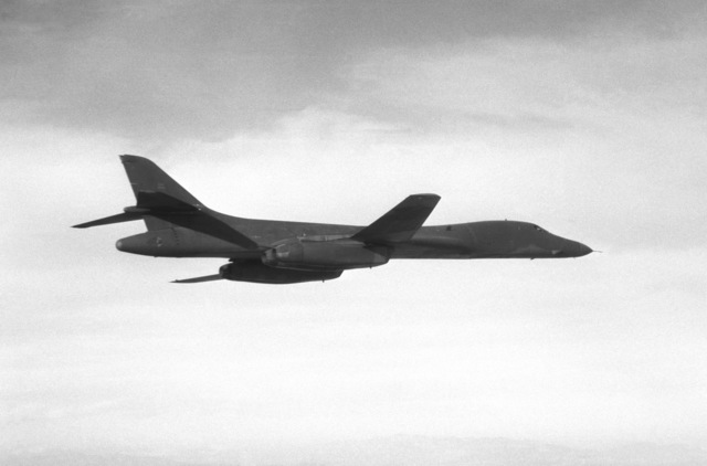 Air-to-air right underside view of a B-1B aircraft during its first flight. The aircraft will travel from Palmdale Rockwell International's production facility to Edwards Air Force Base