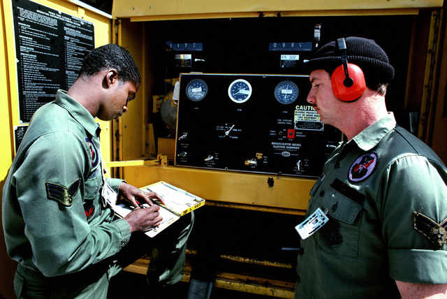 Sergeant (SGT) Larry T. Smith, left and a petroleum, oil and lubrication specialist prepare for aircraft refueling by checking the gauges on a refueling truck. SGT Smith is a crew chief with the 94th Tactical Fighter Squadron. November AIRMAN 83 AIRMAN Magazine