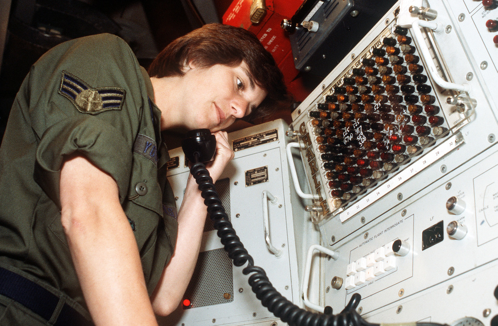 SGT. Mary Young, a missile radio technician, works with communications equipment at the 2152nd Communications Squadron