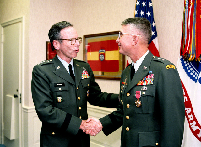 General (GEN) Maxwell R. Thurman, left, vice chief of staff, US Army, presents the Legion of Merit to Major General (MGEN) Stephen R. Woods, director, Program Analysis and Evaluation Directorate