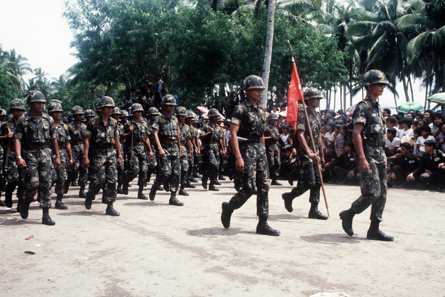 Philippine Marines march in a parade after participating in the reenactment of General MacArthur's landing at Red Beach on October 20, 1944