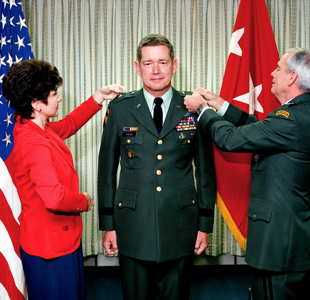 Colonel (COL) Harold T. Fields Jr., center, chief of force planning analysis, office of the deputy to the chief of staff for operations and plans, receives the promotion to brigadier general from Lieutenant General (LGEN) Fred K. Mahaffey, right, deputy to the chief of staff for operations and plans
